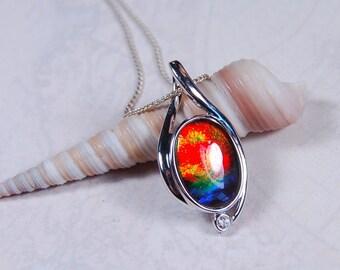 Ammolite Pendant.Grade AA multicolour.Brilliant colour shifter.A jewel box of colour in one pendant.