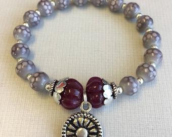 Suma - Gray glass beads and ruby jade bracelet