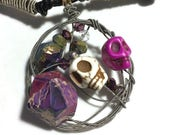 RESERVED - Guitar string circle pendant with skulls and purple-ness