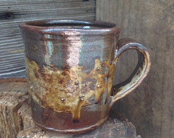 Experimental mugs and cups: ash-belted mug by Joel Patton