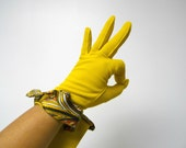 NEW in the PACK!!! . 1960's mod yellow nylon gloves . one size fits all . made in USA