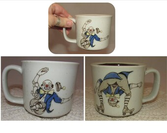 Vintage Stoneware Coffee Cup Mug with Wacky Rolling Skate Clowns, circus clown