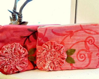 Pink embroidered clutch with applique flower