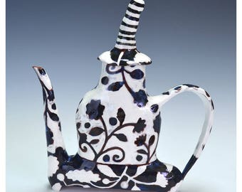 Black and white (night and day pattern) flat profile teapot.