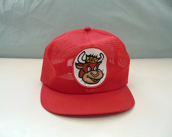 vintage red full mesh trucker hat with ABC bull patch front K brand made in USA snap back