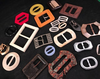 Lot of 23 Belt Buckles in Various Sizes, Styles, and Materials Mother of Pearl Plastic Metal and More
