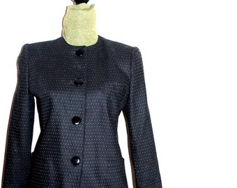 Business vintage 80s black wool blent suit with a tiny white dots. Made by Sasson. Paris-New York. Size 8.