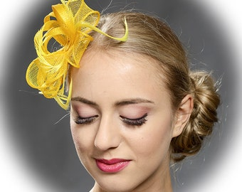 Yellow lovely fascinator trimmed with natural feathers