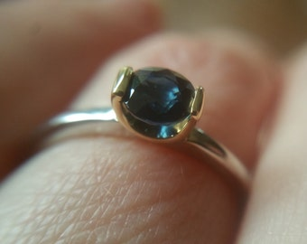 18K gold ring with sapphire. White and yellow gold ring. Sapphire ring. Engagement ring. Modern ring.