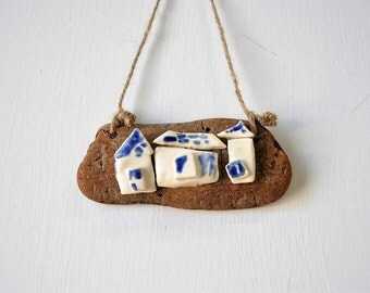 handsculpted clay beach houses on driftwood / wall decor / blue and white houses / driftwood