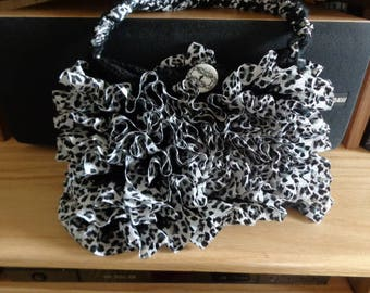Black and white knitted ruffle purse