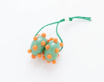 two bumpy beads - green & orange