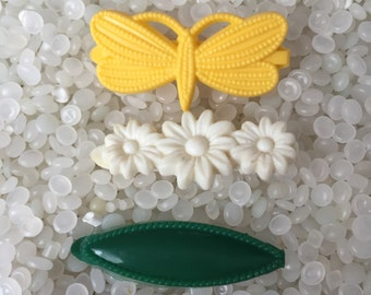 vintage  barrette plastic childs barrettes, soft white flowers, bright yellow butterfly. dark green cats eye
