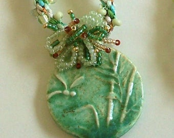 Green Ceramic Dragonfly Pendant with a Beaded Kumihimo Rope with Fringe Embellishment by Carol Wilson of Jet'adorn
