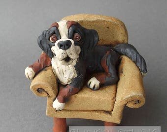 Bernese Mountain Dog on Chair Ceramic Sculpture