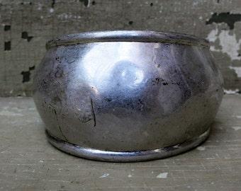 A silver Metal Hinged Bracelet