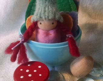 Pretty in pink fairy in Easter Egg with forest treasures!