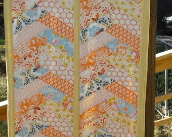 Table or bed runner featuring Sweet as Honey fabrics. Handquilted.