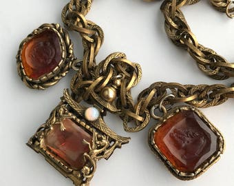 Vintage charm necklace . Cameo . Intaglio . Fob Charms . Opal Glass  . Dragon Griffin . Costume jewelry