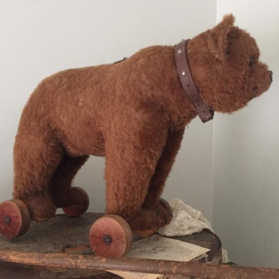 Steiff Bear with wooden wheels, original shoe button eyes, wood wool fill, Antique teddy Bear, Steiff, German Bear, Roosevelt Bear.