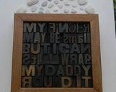 My finger may be small but I can still wrap my daddy round it. Collage of vintage letterpress wooden printing blocks.