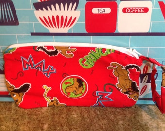 Handmade zippered wristlet.  Dr. Seuss The Grinch Who Stole Christmas max dog purse.  Fully lined.