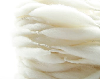 100 yards and 7 ounces/ 200 grams hand spun yarn, super bulky, in thick and thin natural cream merino wool