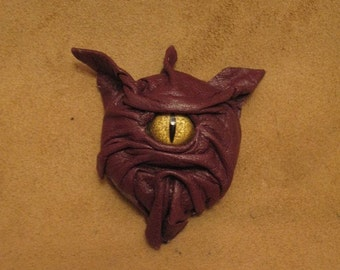 Grichel leather magnet - mauve purple with gold speckled slit pupil reptile eye