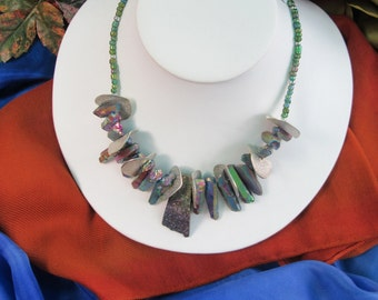 Edgy and eye-catching, silver disc and iridescent quartz necklace