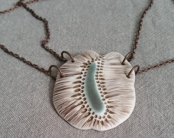 SEED - A unique porcelain necklace inspired by images of microscopic seeds.  Handmade ceramic jewelry.