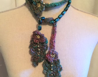 A Whimsical Necklace Beads Leaves and An Icord...Colorful but Muted