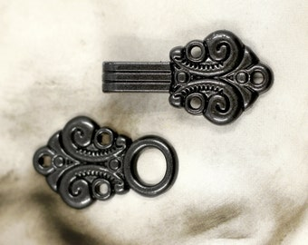 HOOK And EYE Fasteners - Scroll Flower Cloak Clasp Black Gunmetal Fasteners.  5 Pairs.
