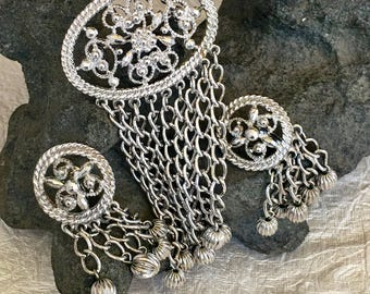 Sarah Coventry Vintage silver tone brooch and earrings .