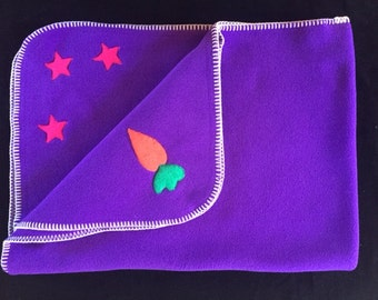 Hotsy Totsy of Vermont fleece whip stitched baby blanket in Purple with appliquéd Carrots and Stars (all 4 corners are appliqued).