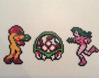 3 pixel/bead sprite figures inspired by Metroid and Samus Aran
