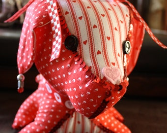 Decorated Stuffed Dog in Red and White Hearts with Red Sequin Trim