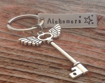 Alohomora hand stamped keychain inspired by Harry Potter inspired with a winged key charm