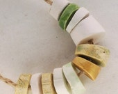 It is enough -- a set of 11 green, white and gold small ceramic beads