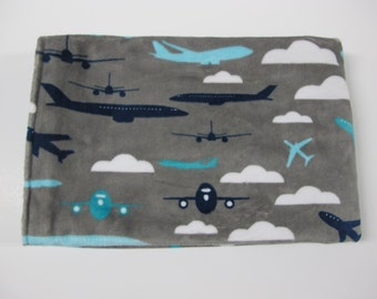 Airplane and arrows baby boy blanket in grey, white, navy, and turquoise