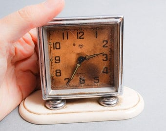 Vintage metal mechanical alarm clock from Soviet Russia 1950-1960