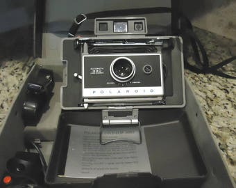 Vintage Polaroid 330 camera with flash and case