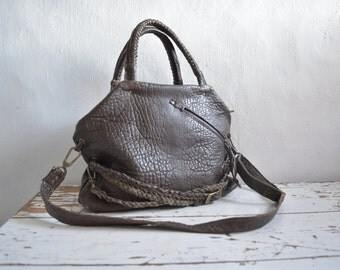 Brown Top Handled Slouchy Top Handled Leather Purse with Straps and Front Pocket. Available in Black and other colours. Made to Order