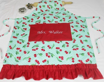 Personalized and Ruffled Aqua Cherries Adult Apron with red pocket and ruffle - made to order