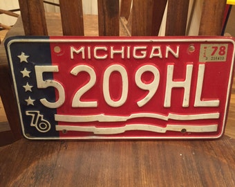 Vintage license plate, old, automobile plate, 1976, rustic, antique plate, metal plate, michigan, red white and blue, bicentennial