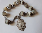 Antique French religious pearl beaded bracelet w big mother of pearl beads w silver miraculous medal w chalice, first Holy communion gift