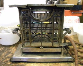 good shape vintage antique 1920s LANDERS FRARY and CLARK art deco swing arm electric toaster