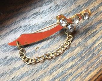 gold rhinestone sword brooch