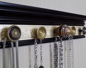 You choose 5, 7 or 9 knobs Jewelry Organizer.This wall hanging necklace holder on black w/ champagne embossed background Jewelry storage