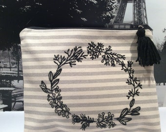 Canvas pouch hand embroidered with black wreath,  grey and off white strippes pouch,  black tassel  detailing , handmade, one of a kind