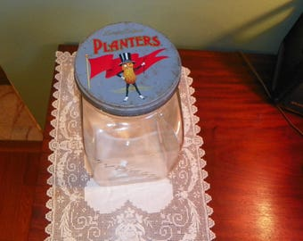 Antique vintage Country Store PLANTERS  DISPLAY JAR Leap Year 1940 Embossed tin Lid glass